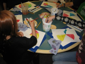 children painting at the library